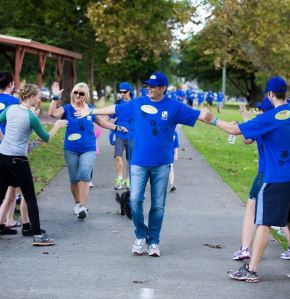 Crossing the finish line last year with Lenore (at an MND  fundraiser event).